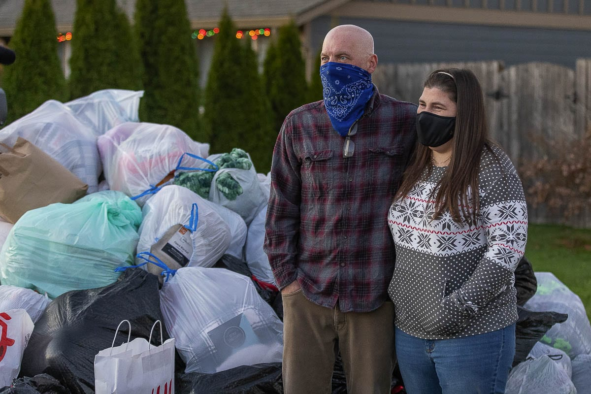 Josh and Nadine McCrow were stunned by how many blankets were donated Sunday at their home in Vancouver. The McCrows donate to Doernbecher Children's Hospital every year in memory of their daughter Hailey. Photo by Mike Schultz