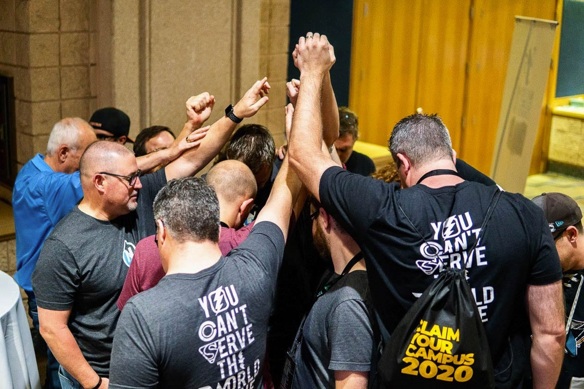 Part of the NNYM Team is seen here in a prayer huddle after over 400 conversations with youth workers in Tampa, FLA over three days. Photo courtesy of Philip Ball