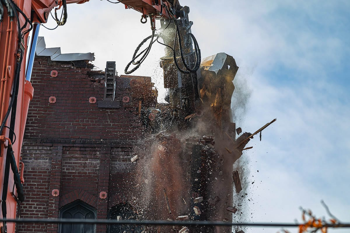 A massive hydraulic claw makes short work of the brick walls at the old New Heights church building in downtown Vancouver. Photo by Mike Schultz