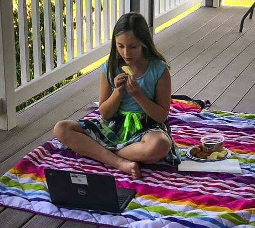 South Ridge Elementary School fourth grader Sidney Krause enjoys lunch while connecting remotely via Zoom with her classmates and teacher Karen Moses during a recent Friendship Fiesta lunch on Oct. 2. Photo courtesy of Ridgefield Public Schools