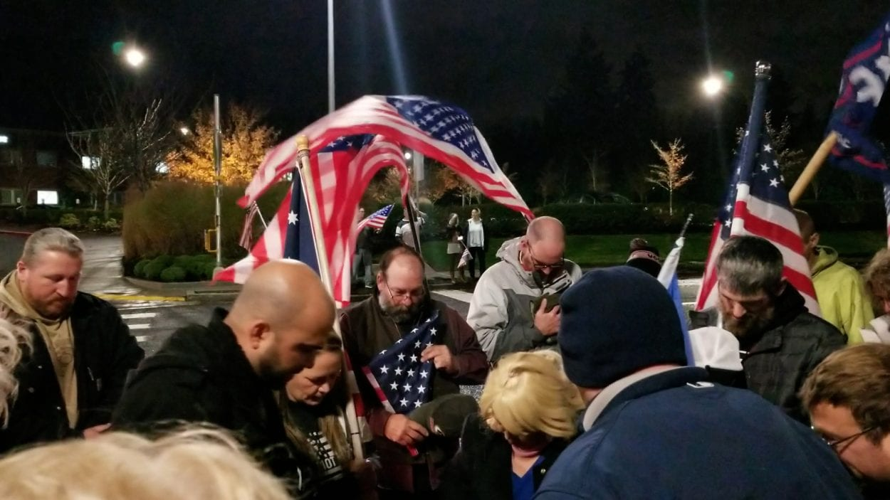 Friends gather outside a local hospital, saying the Pledge of Allegiance and a prayer for their friend, Dave Alt. Photo by John Ley