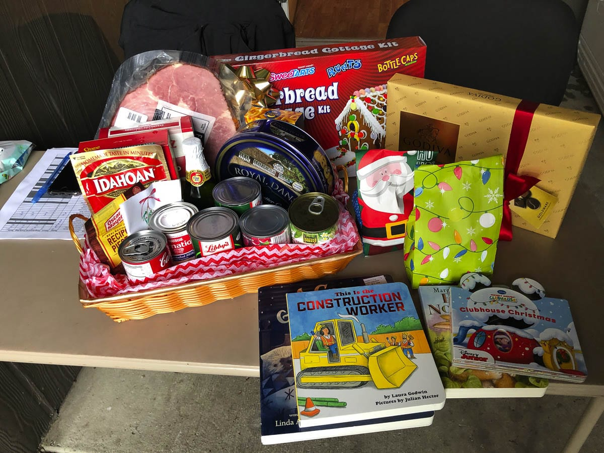 With the pooled resources of Katerra and the apartment management, the gift baskets are much more vibrant and full this year, with something for everyone. Photo courtesy of Chris Swagerty