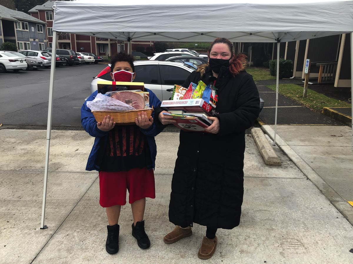 Residents pick-up their holiday gift baskets from Katerra and the management about a week before Christmas. Photo courtesy of Chris Swagerty