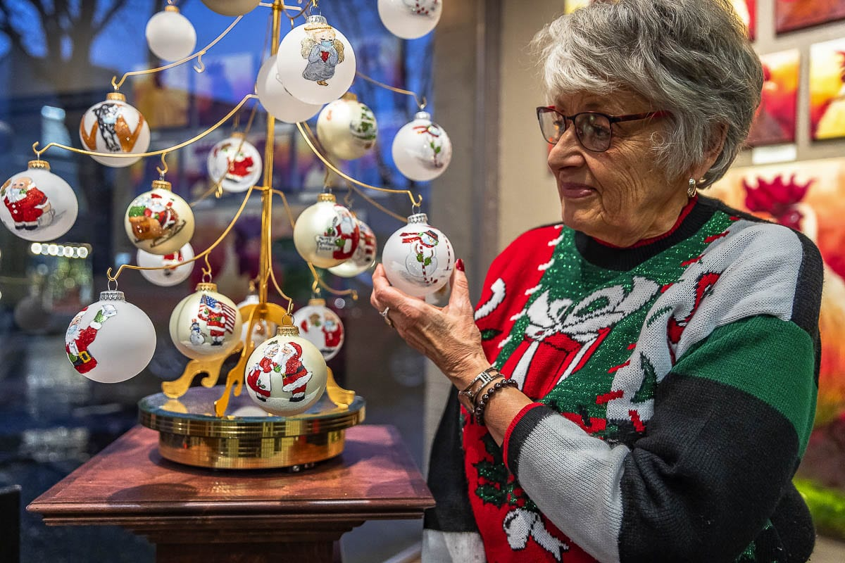 Artist Bev Birdwell shows off her unique Covid-themed Christmas ornaments at the Camas Gallery. The creative characters all feature masks and are designed to put a smile on your face. Photo by Mike Schultz