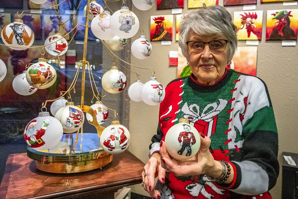 A display in the Camas Gallery shows off the variety of Covid-themed Christmas ornaments created by Bev Birdwell. Photo by Mike Schultz
