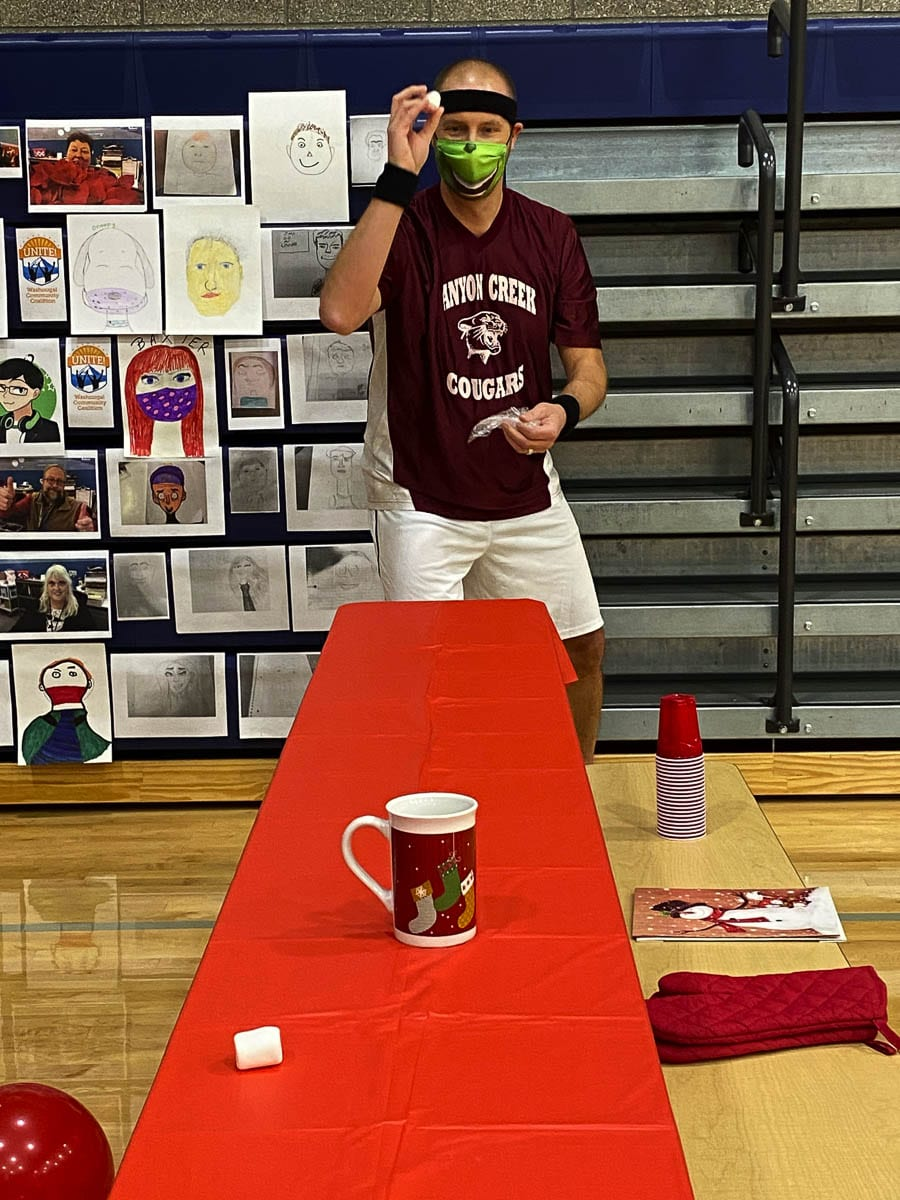 Canyon Creek Middle School principal Brian Amundson takes aim in the Marshmallow Toss Challenge. Photo courtesy of Washougal School District