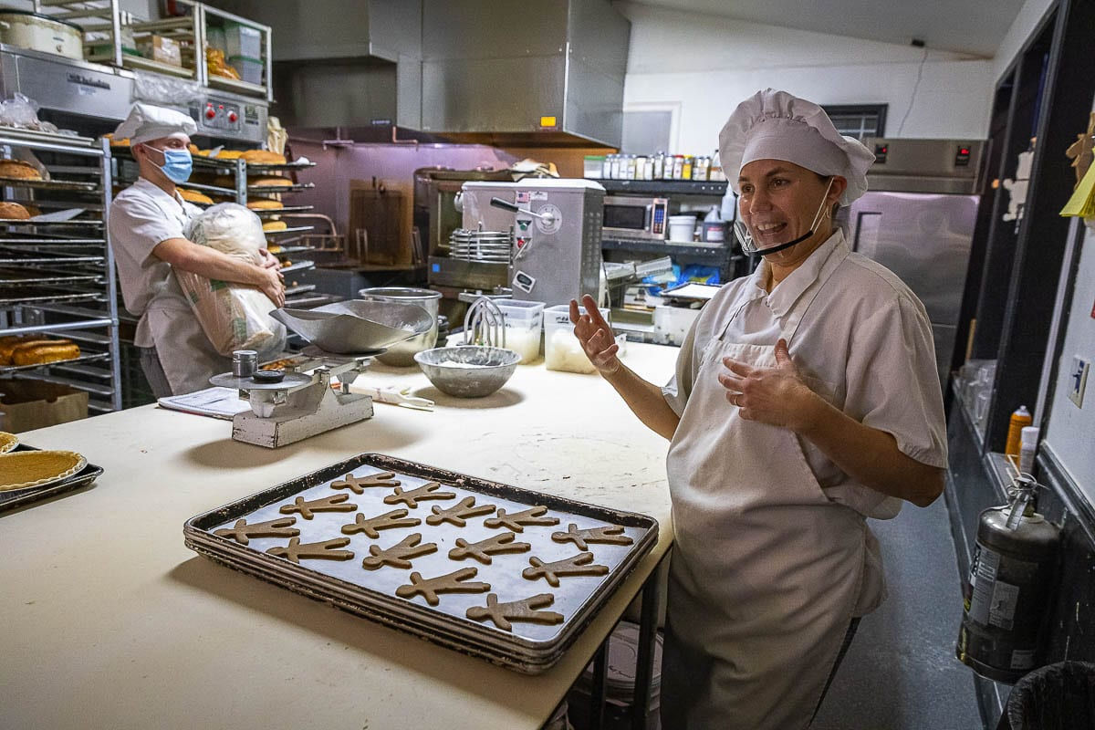 Sadie Shapovalov talks about the love of baking as she and her nephew Cedric Hubler prepare the goods Wednesday morning at Sadie and Josie's Bakery in La Center. Photo by Mike Schultz