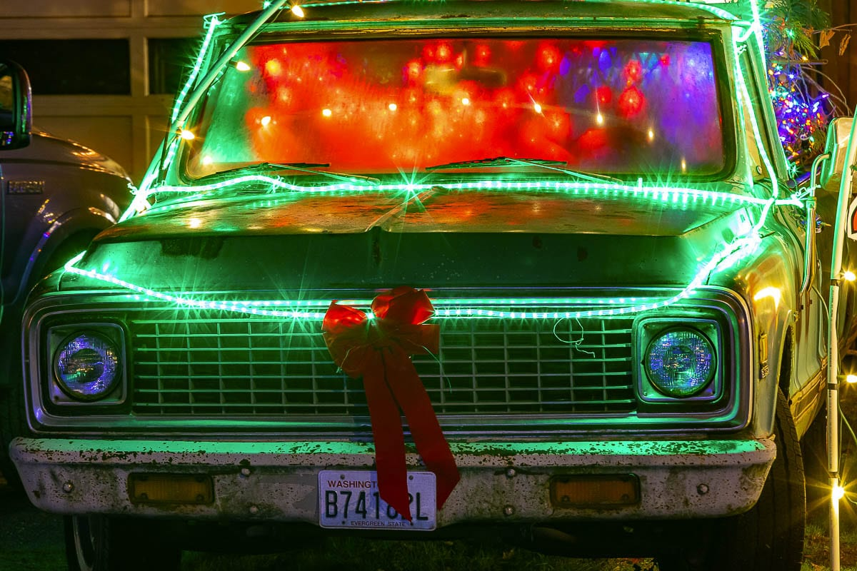 The Grinch loads gifts into an old pickup truck as part of the Holidays on Franklin Christmas display in Vancouver. Photo by Mike Schultz