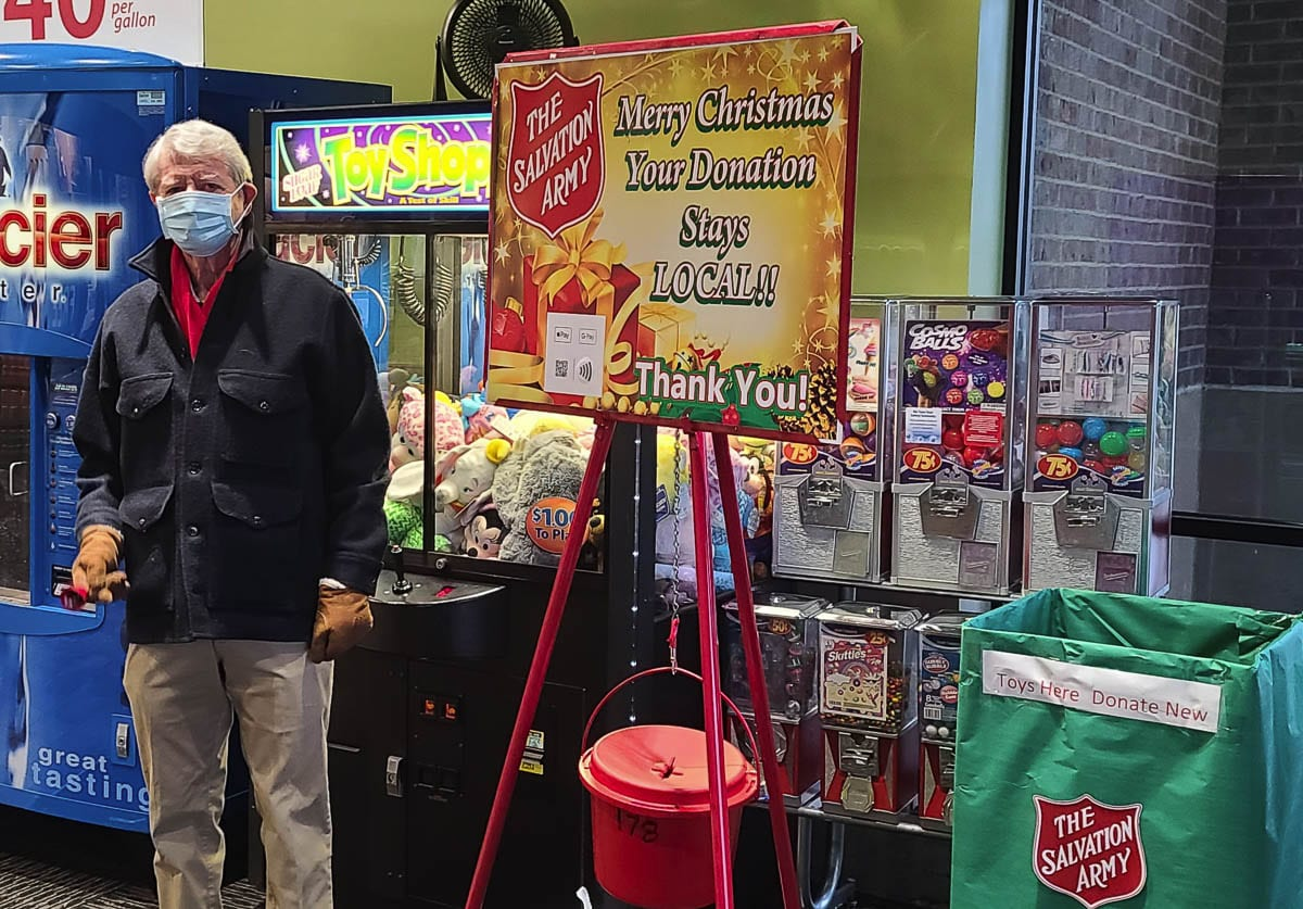 Chuck Mulligan, a retiree from Vancouver, rings the bell for the Salvation Army on Friday. This is his 58th consecutive year as a volunteer for the program. Photo by Paul Valencia