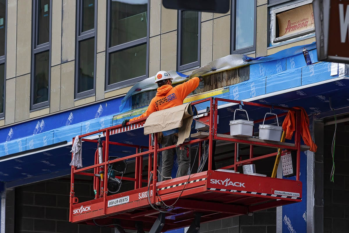 Construction crews work on a building in downtown Vancouver. File photo