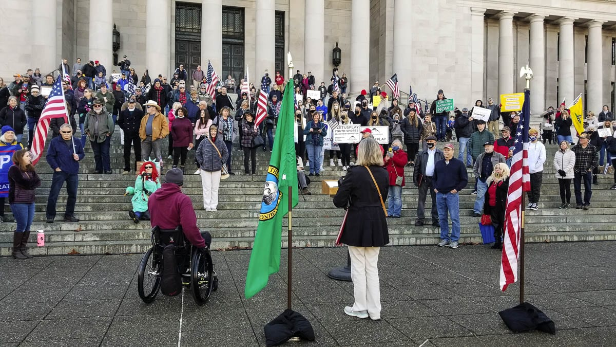 Rep. Vicki Kraft (17th District) addresses the crowd at the Reopen Washington rally at the state capitol on Saturday. The rally provided citizens an opportunity to voice their concerns and petition their government to reopen Washington. Photo by John Ley