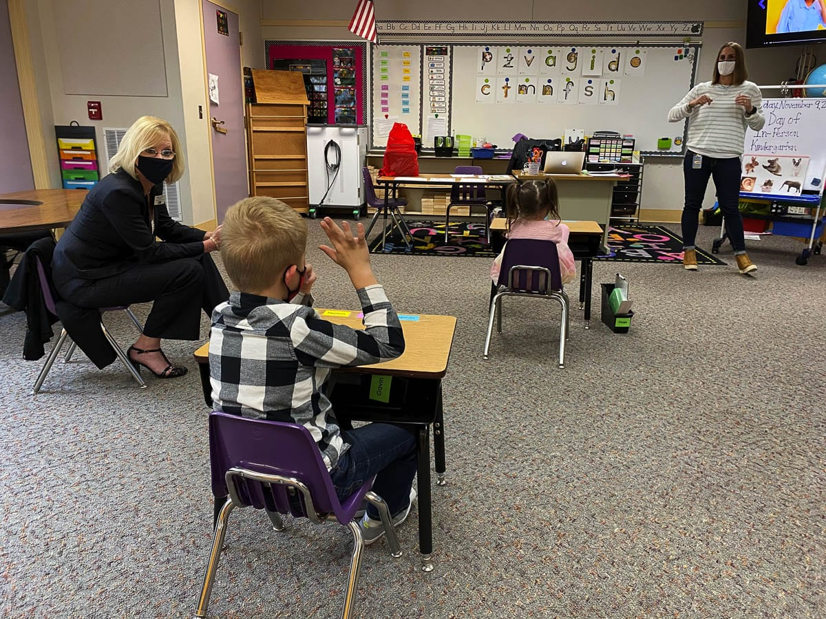 Washougal Schools Superintendent Mary Templeton observes a classroom where children are socially distanced. Photo courtesy of Washougal School District