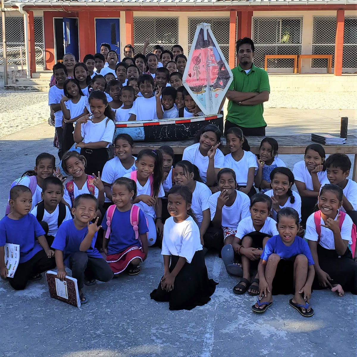 The school children who located the mini boat in Ailuk are seen here with the S/V Liberty. Photo courtesy of CRMM