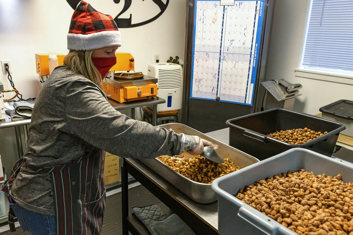 Theresa Jones works with roasting nuts at NW Nut, a seasonal shop in Ridgefield. Photo by Mike Schultz