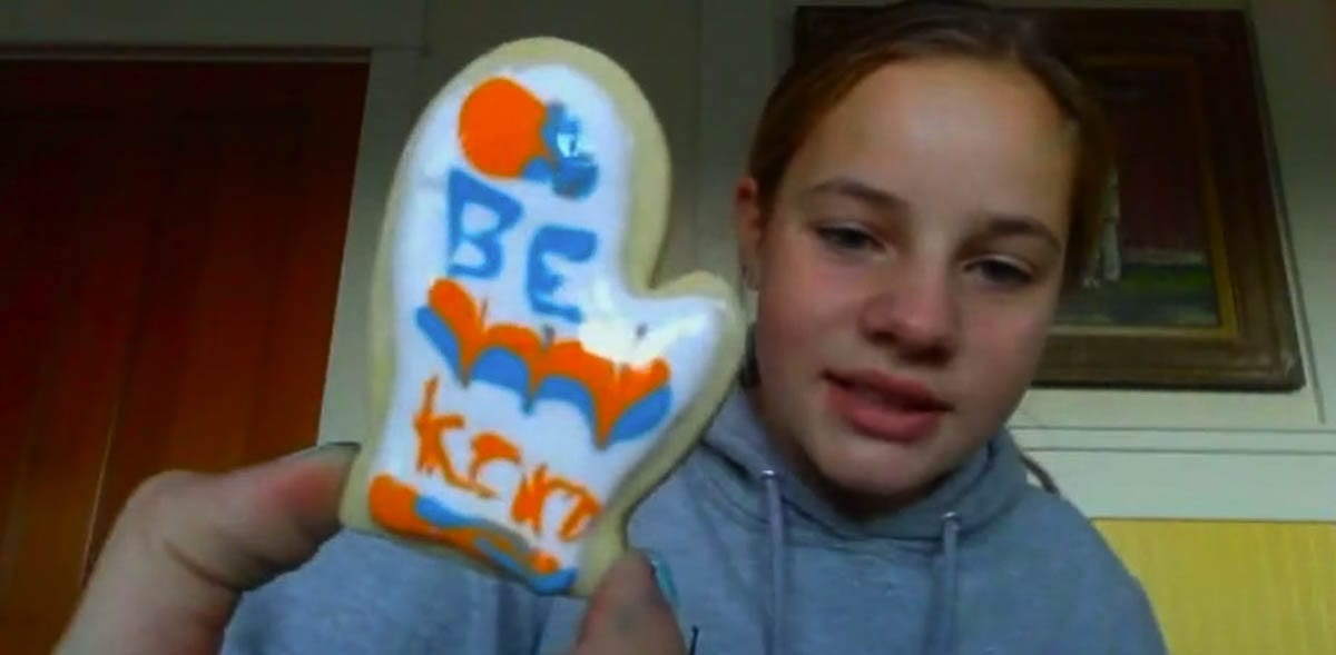 "ASB Leadership student, Elizabeth Jones, made a ""Be Kind"" mitten cookie. Downloadable file: Kayla Mitchell with her sons, Jaden and Ronin, decorated Santa cupcakes. Photo courtesy of Ridgefield School District"