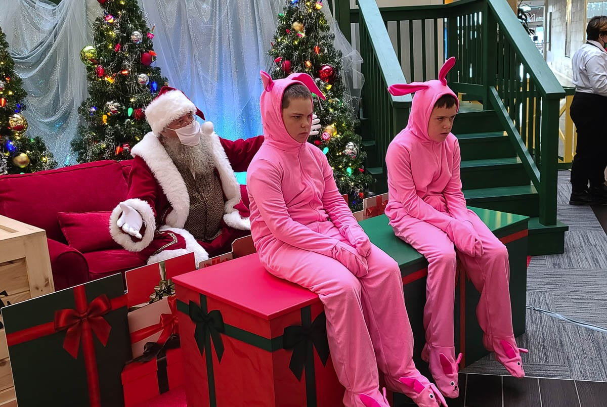 "Carson Asay, 12, (left) and his brother Cruz Asay, 10, act out their disapproval of being ""made"" to wear pink bunny pajamas during their Monday visit with Santa Claus at the Vancouver Mall. Photo by Paul Valencia"