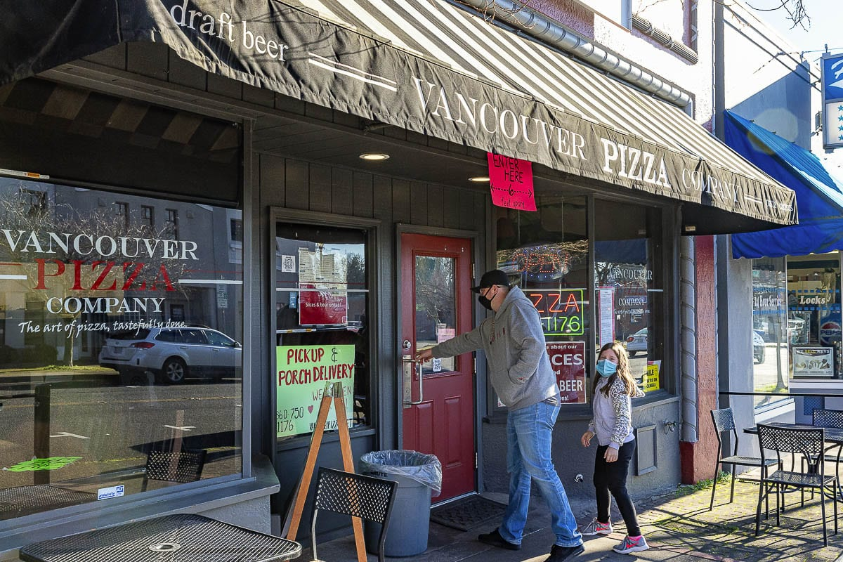 Customers enter Vancouver Pizza Company, which announced late last week that they'll be closing for good at the end of the year. Photo by Mike Schultz