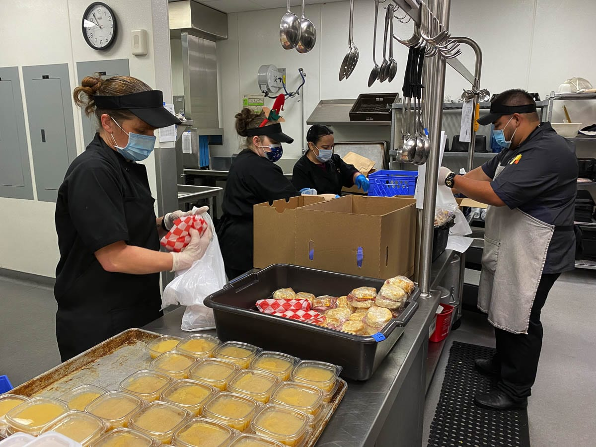 The Washougal School District food preparation team prepares meals for the district's meal distribution program. Photo courtesy of Washougal School District