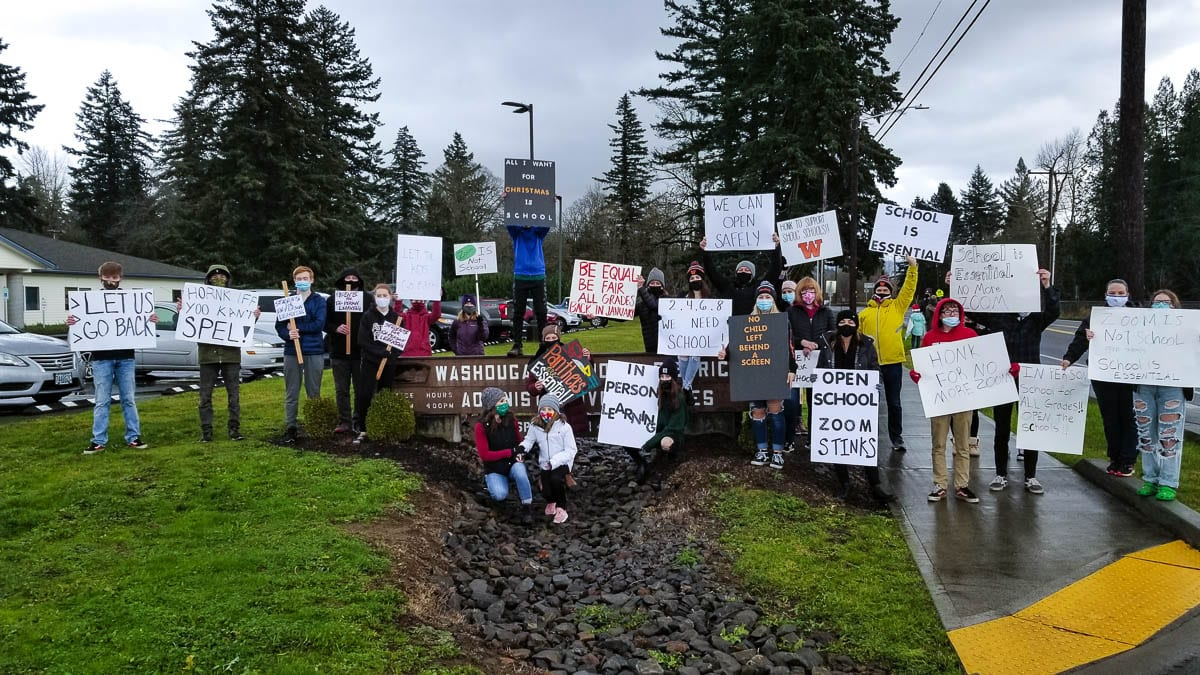 Parents and students rally in front of the Washougal School District offices on Thursday afternoon, pushing for parental choice and in-classroom learning for all students. Photo by John Ley