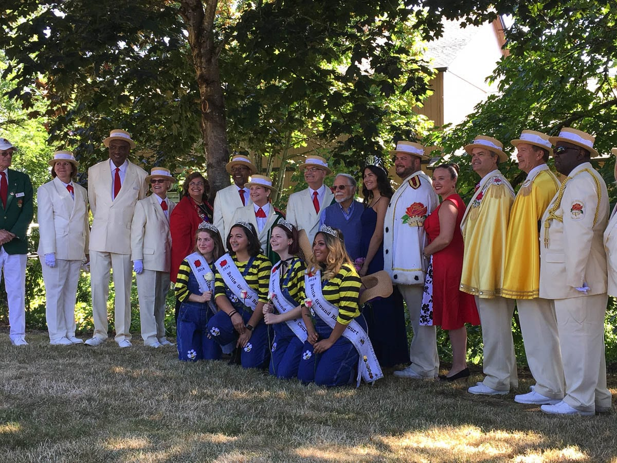 2018 Battle Ground Citizen of the Year, Peter Bascetta (center), is shown here at the Rose Ceremony honoring him during Harvest Days. Bascetta is surrounded by the Royal Rosarians of Portland, Rose Festival Queen Kiara Johnson, and the Battle Ground Royal Princess Court. Photo courtesy of Battle Ground Citizen of the Year program