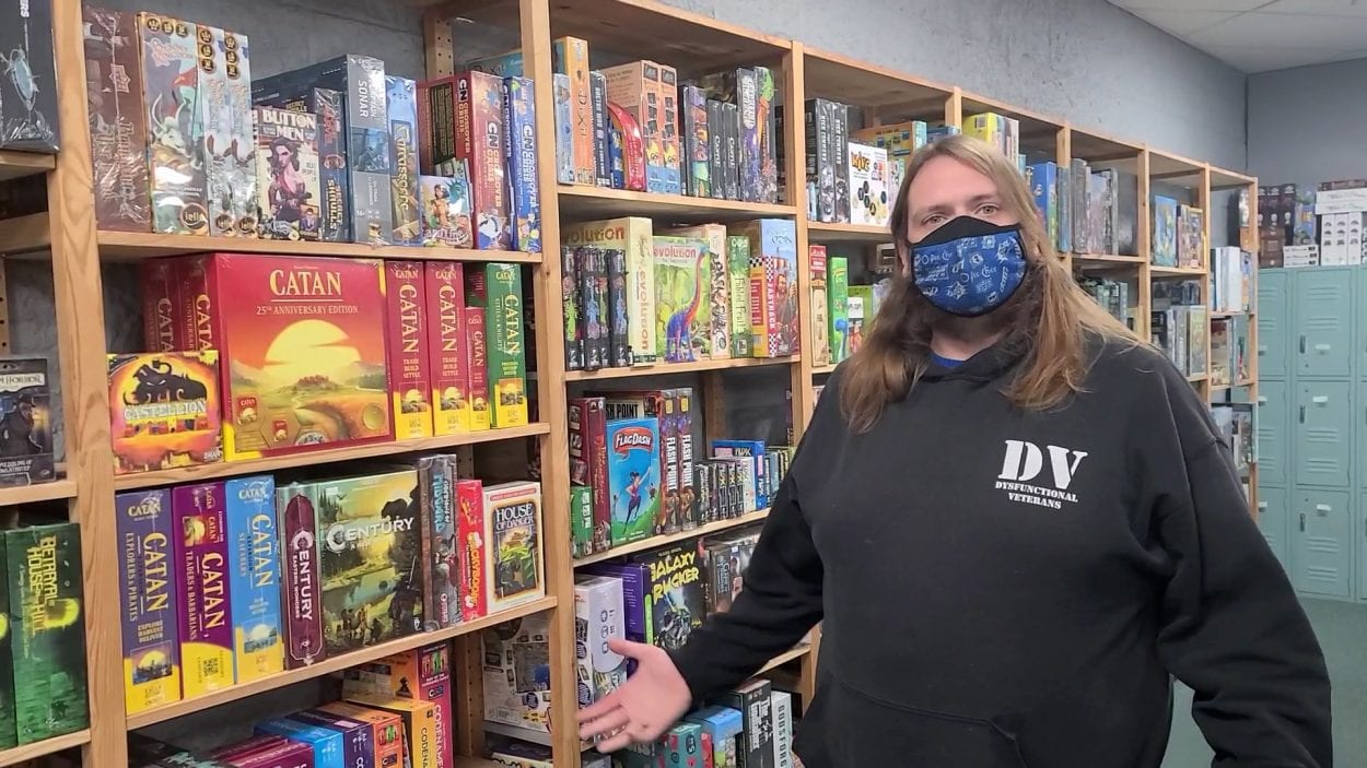 Chris Heagy grew up playing games, loves to share his passion for games, which makes managing BatCave Games a perfect opportunity for him. Photo by Paul Valencia