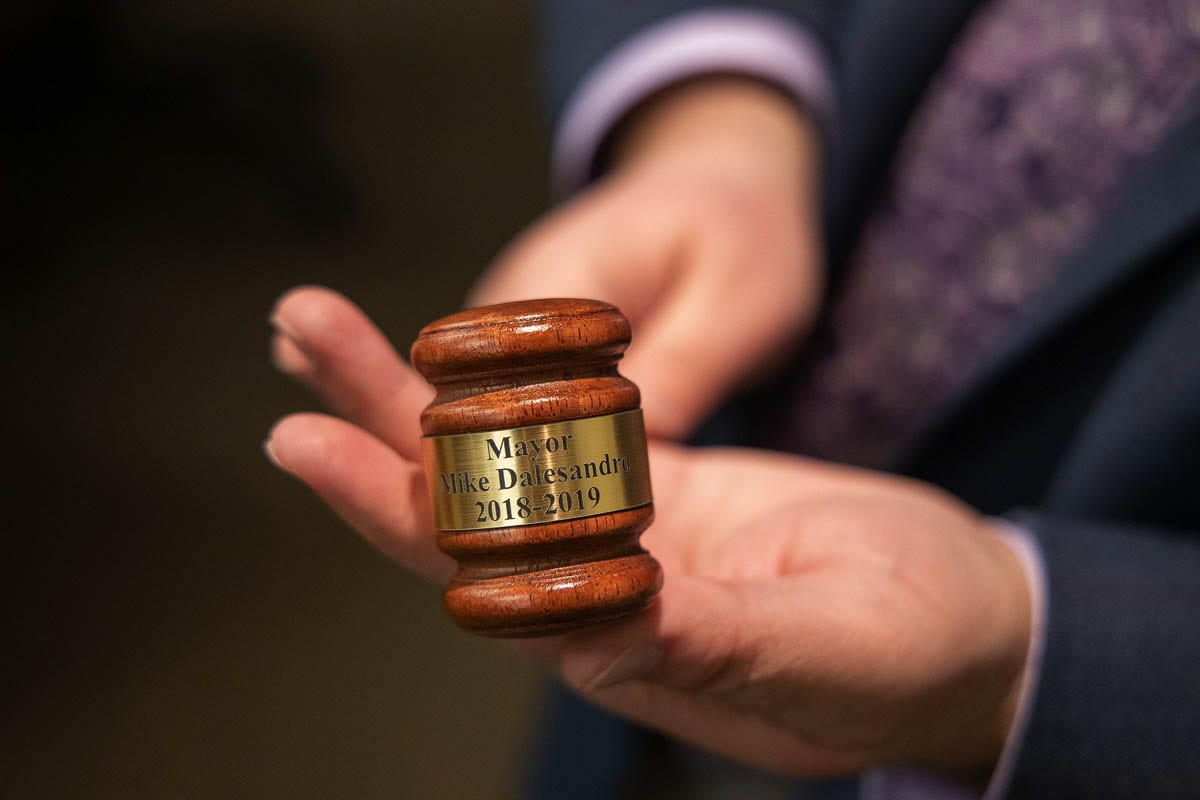 Battle Ground City Councilor Mike Dalesandro shows off a ceremonial gavel he received commemorating his time as mayor. Photo by Chris Brown