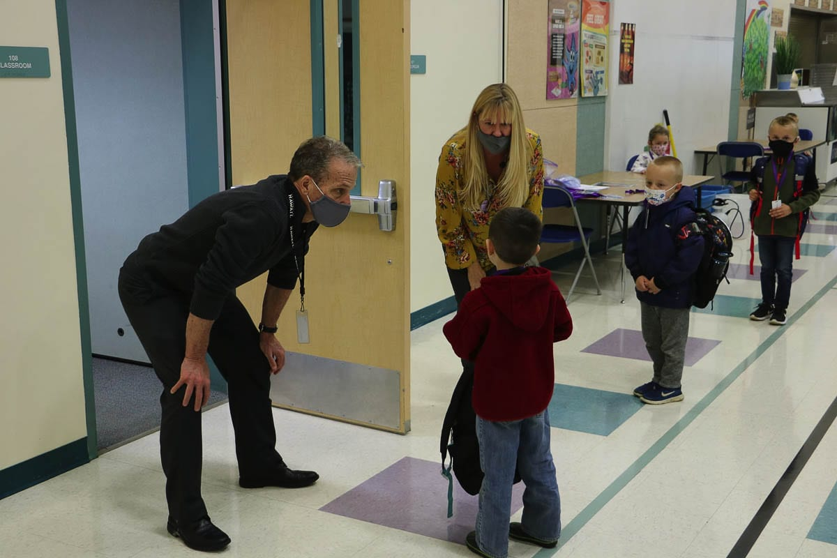 Battle Ground Deputy Superintendent Denny Waters greets kindergarten students on their first day back in classrooms last November. Photo courtesy Battle Ground Public Schools