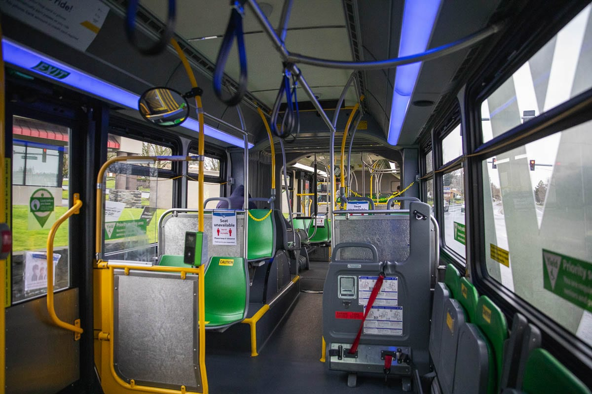 In addition to hydrostatic sprayers, cleaning crews also wipe down all the high-touch areas on the buses, such as hand straps and pull cords. Photo by Jacob Granneman