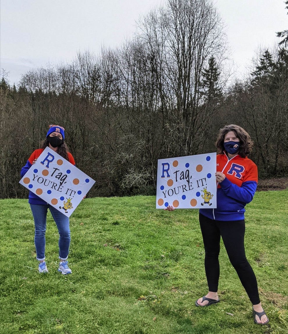 Cheerleading coaches Alyssa Tomillo and Anja Felton kicked off the game of yard sign tag. Photo courtesy of Ridgefield School District