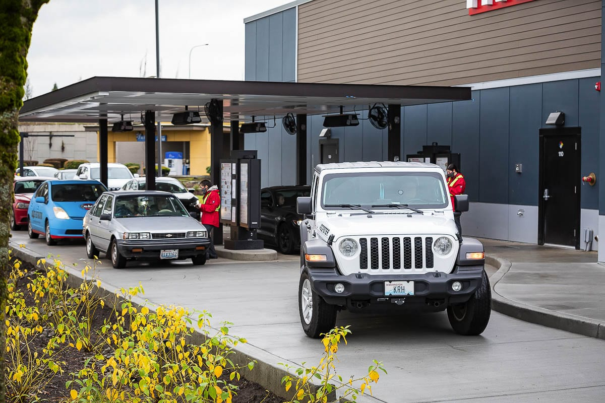 Keith Hallett, in the white Jeep, said he arrived at around 7 a.m. to make sure he was one of the first in line when the Chick-fil-A at Vancouver Mall opened at 11 a.m. Photo by Mike Schultz