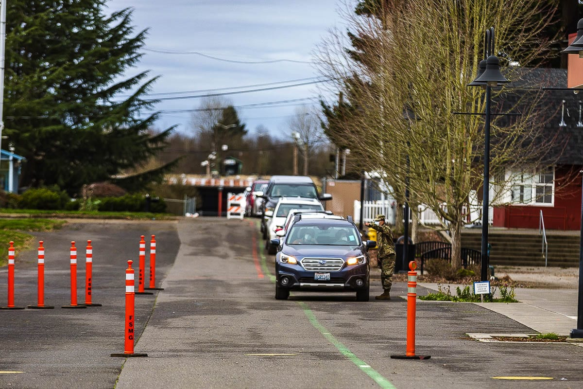 Cars lined up Tuesday morning outside the Clark County Event Center, waiting to be one of the first to be vaccinated at Southwest Washington's first mass vaccination clinic. Photo by Mike Schultz