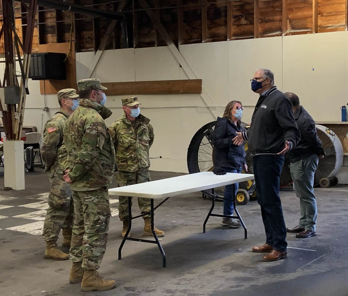Gov. Jay Inslee talks with members of the Washington National Guard while visiting a mass vaccination site at the Clark County Fairgrounds on Thursday. Photo courtesy Office of Governor Jay Inslee