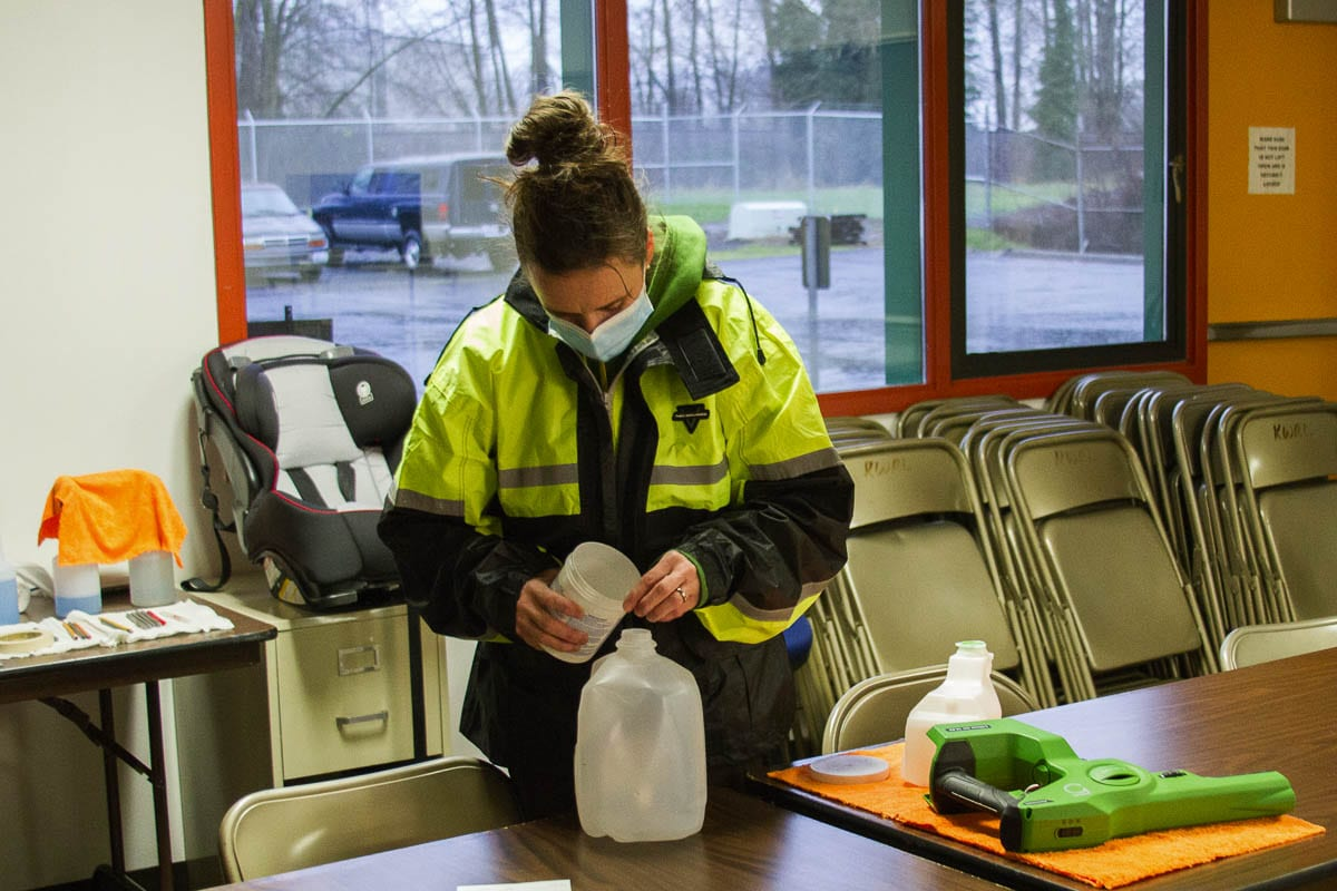Mary Martin mixes the cleaning solution used in the electrostatic sprayers and prepares disinfecting supplies. Photo courtesy of Woodland Public Schools