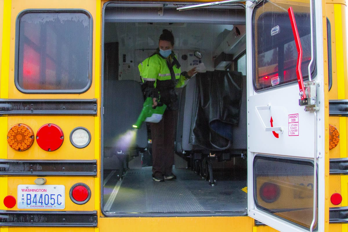 Mary Martin, a KWRL driver, uses a special electrostatic sprayer to clean buses using fog cleanser and static electricity. Photo courtesy of Woodland Public Schools