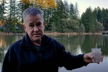 County Councilor Gary Medvigy works to clean up Lacamas Lake water