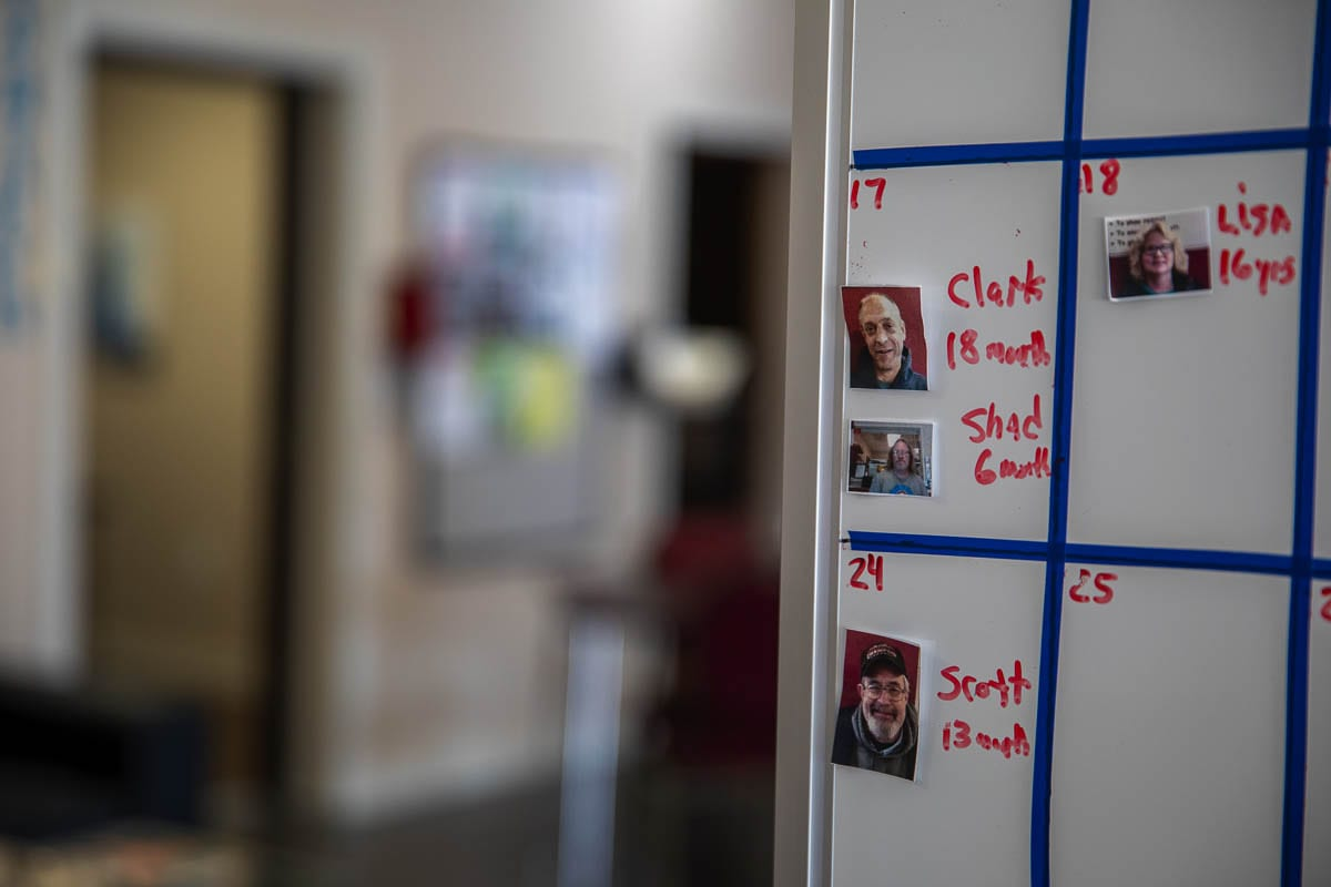"""Each month, a board in the café displays the names of members whose """"birthday"""" it is. At the café this is the starting day of your recovery. Photo by Jacob Granneman"""