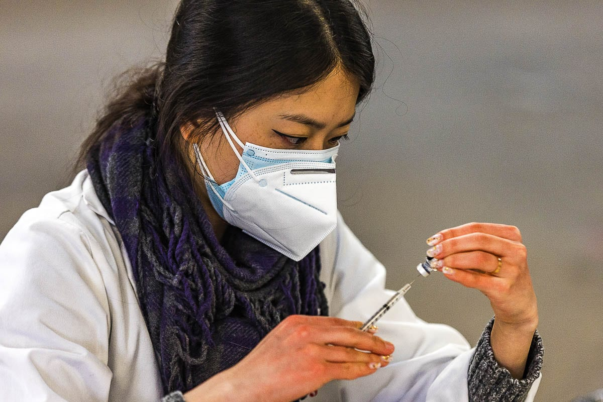 Safeway Pharmacist Jennifer Park draws a dose of COVID-19 vaccine from a Pfizer-BioNTech bottle at the Clark County Fairgrounds on Tuesday. Photo by Mike Schultz