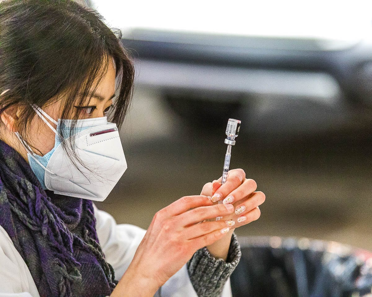 Safeway Pharmacist Jennifer Park draws a vaccine dose at the Clark County Fairgrounds vaccination site on Tuesday. Photo by Mike Schultz