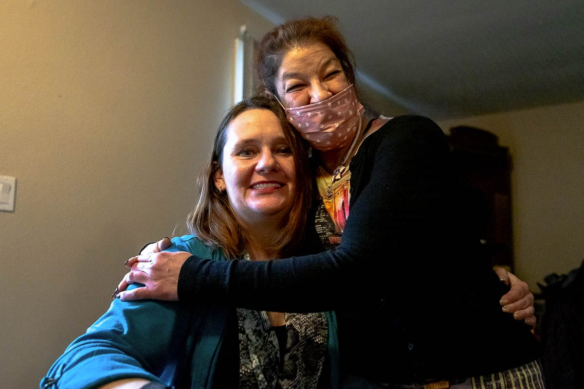 Tessa Skilton, left, and her friend Alicia Stanard are thrilled that Skilton has her own apartment. Skilton spent 10 years on the streets, homeless. Photo by Mike Schultz