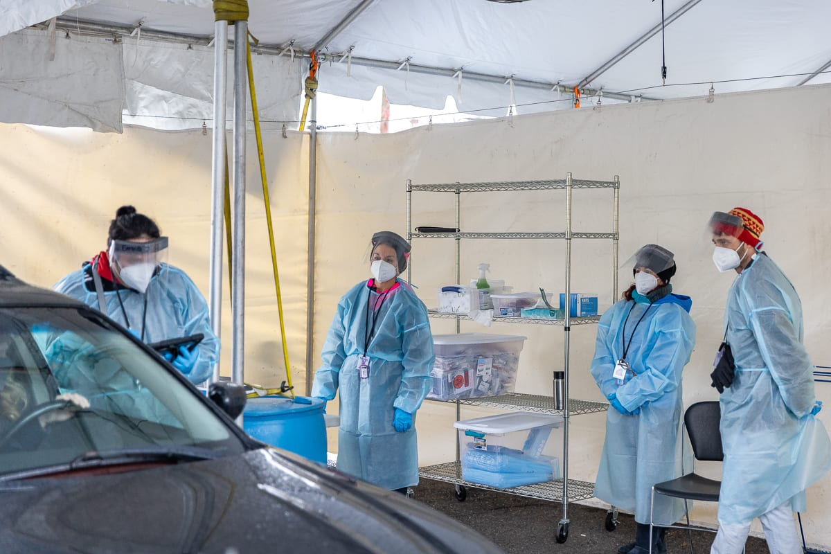 Test observers work to collect COVID-19 test samples at a free no-barrier clinic launching Tuesday at the Tower Mall site. Photo by Mike Schultz