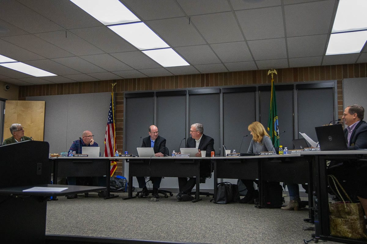 Monty Anderson, center, listens to debate about Comprehensive Sexual Education curriculum during a school board meeting in 2019. Photo by Chris Brown