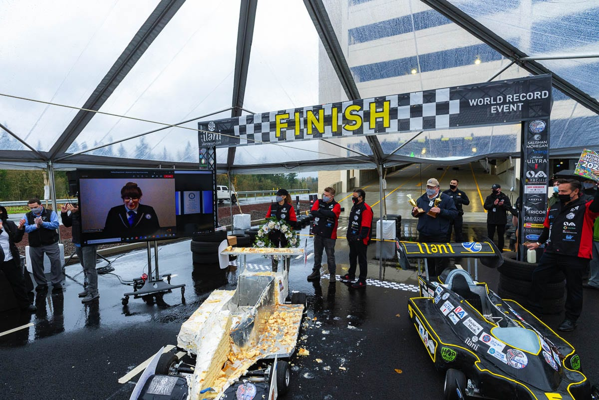 "Before it was ""disassembled,"" legendary race car driver Michael Andretti drove a cake car down the ramp at the new parking garage at ilani casino, setting two Guinness World Records. Photo courtesy ilani"