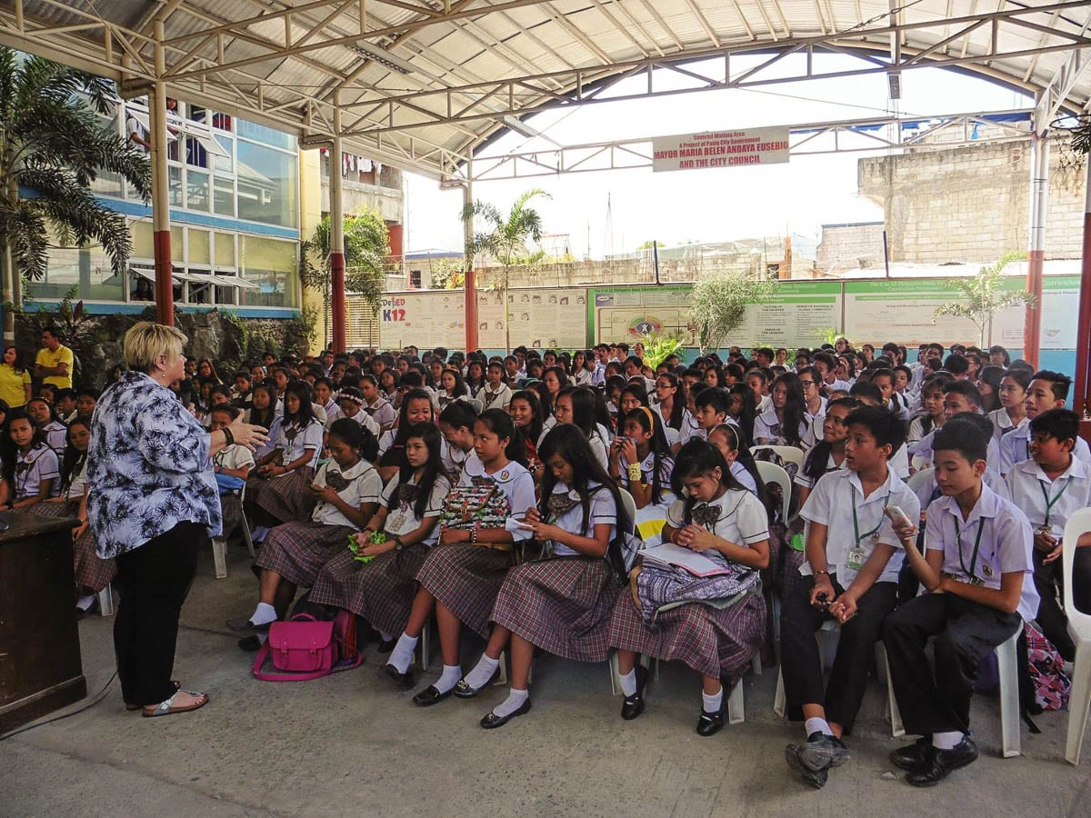 Dr. Cyndi Romine speaks to a group of children in the Philippines during an educational event aimed at helping young people recognize dangerous situations. Photo courtesy of Called To Rescue