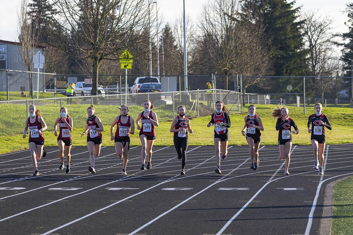 Camas and Union runners take off at the start of their race Wednesday at Camas High School. Cross country is one of the three sports that started competing this week, in the return of high school sports. Photo by Mike Schultz