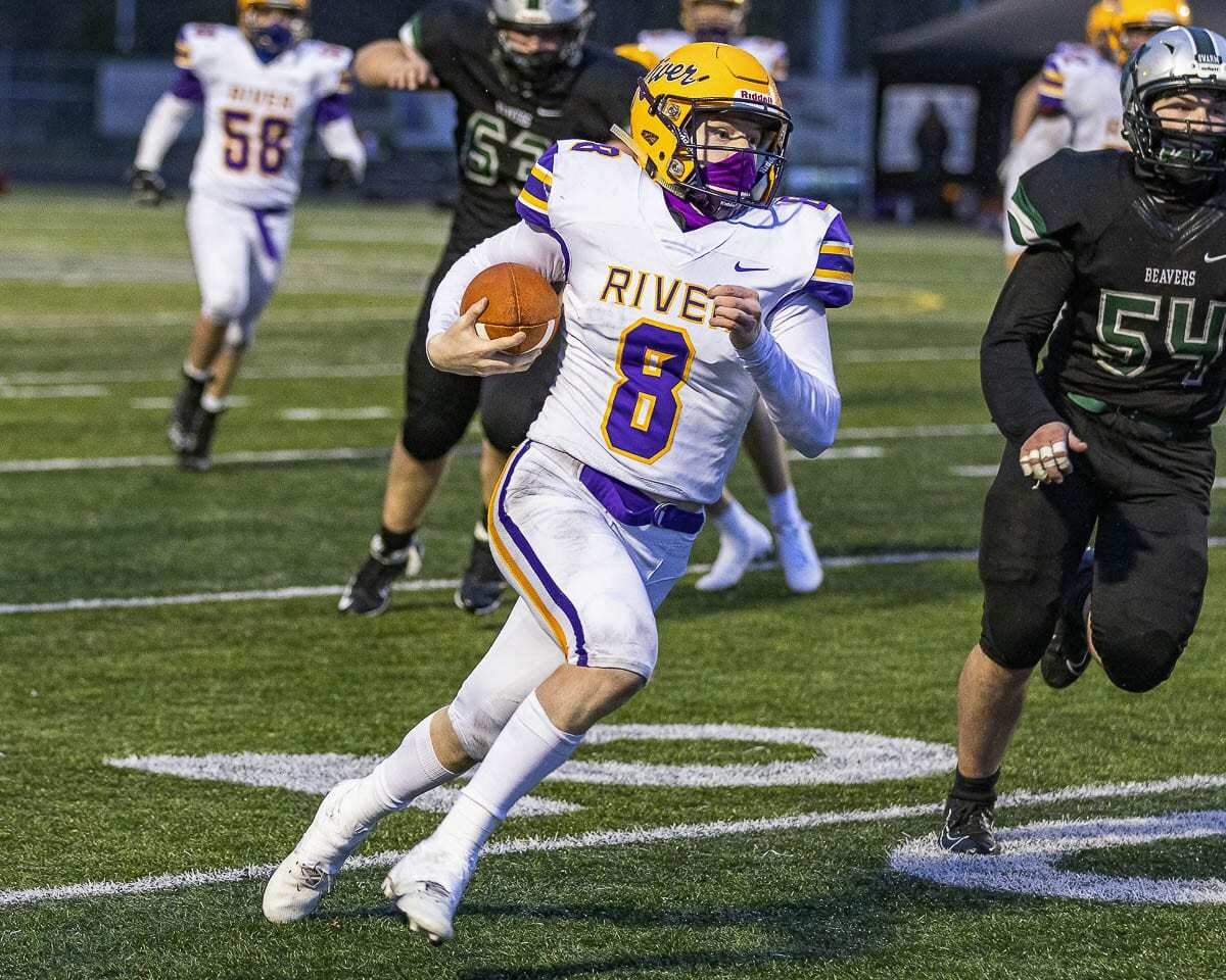 Columbia River quarterback Mason Priddy threw a touchdown pass and rushed for one in River's 22-13 win over Woodland on Saturday. Photo by Mike Schultz