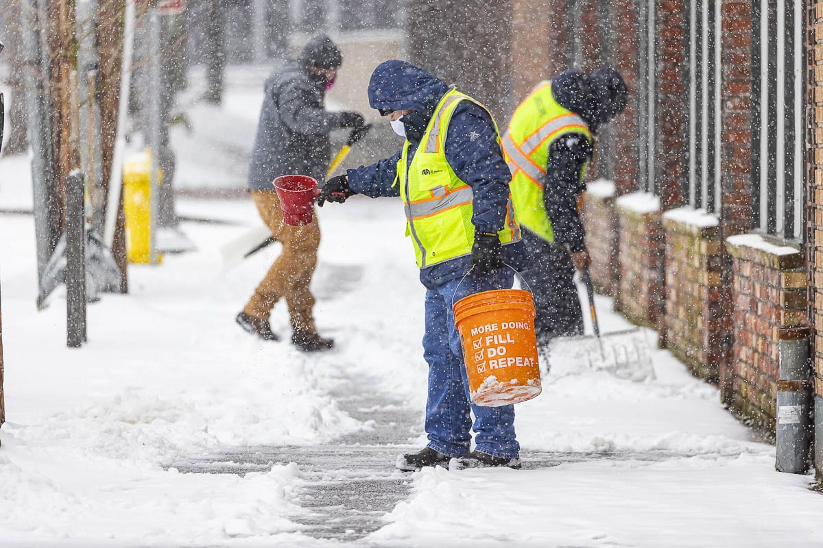 Crews work to shovel and salt treacherous sidewalks in downtown Vancouver on Friday. Photo by Mike Schultz