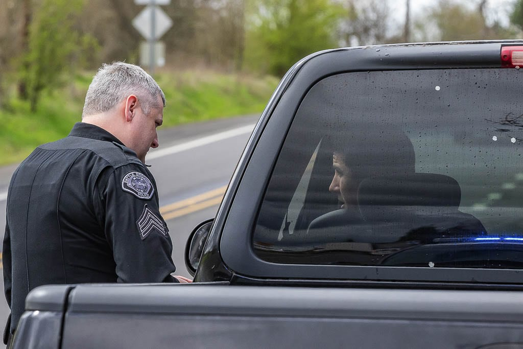 Sgt. Tim Wilson with the Battle Ground Police Department is shown here talking with a driver after pulling them over in 2019. Photo by Mike Schultz