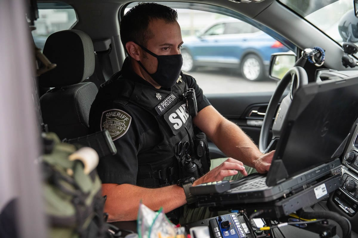 CCSO Deputy Ryan Preston, is seen here processing a ticket after a traffic stop for a different Target Zero funded emphasis patrol on distracted driving. Photo by Jacob Granneman