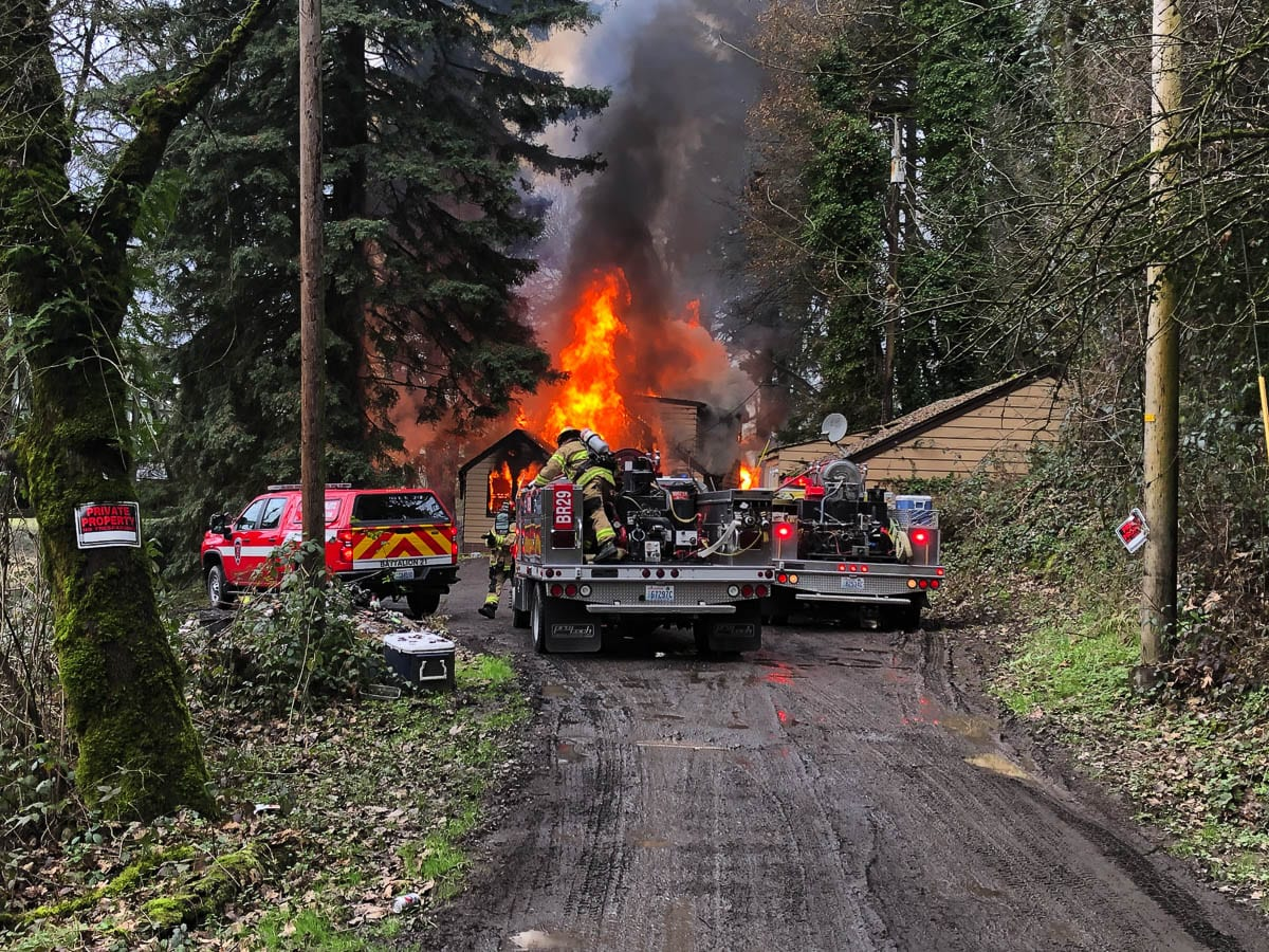 Crews from Clark-Cowlitz Fire Rescue faced significant access challenges to battle a blaze at a residence near Woodland Monday afternoon. Photo courtesy Clark-Cowlitz Fire Rescue