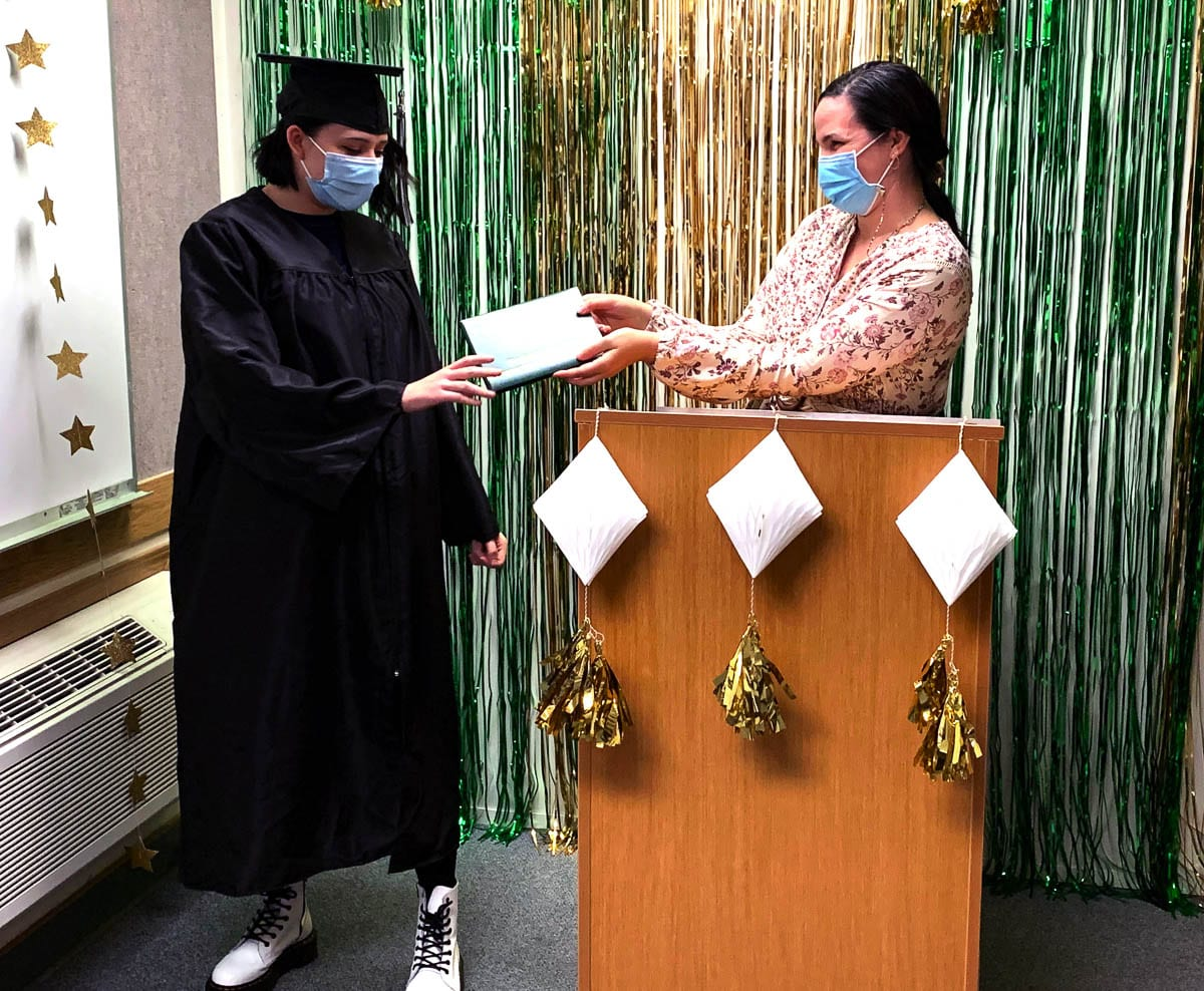 TEAM's staff, including Math and Science teacher Elizabeth Vallaire, kept the ceremony small to maintain social distancing restrictions and required all attendees to wear masks throughout the commencement. Photo courtesy of Woodland School District
